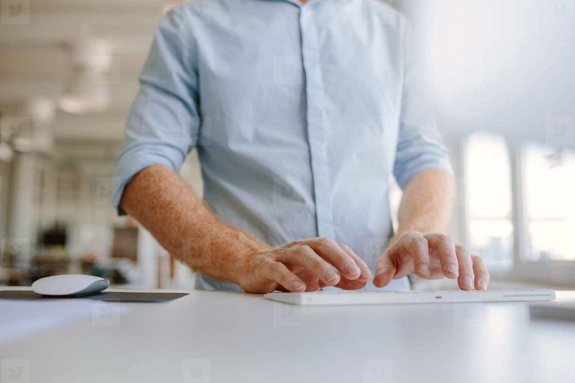 Businessman hands typing on computer keyboard