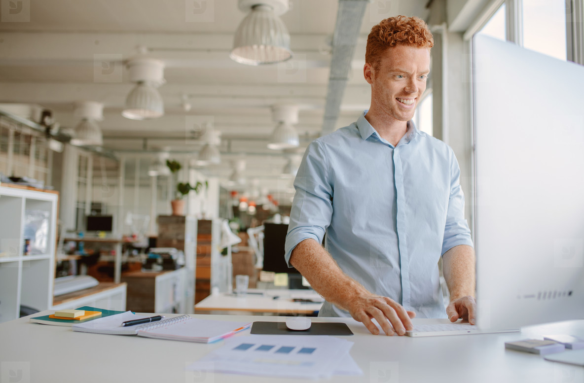 Young man working in modern office