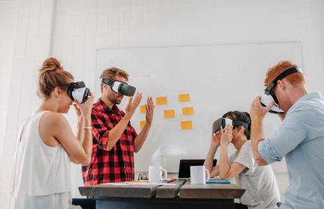 Team developers testing virtual reality headset