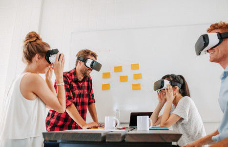 Business colleagues brainstorming using VR goggles