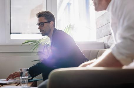 Businessman explaining business plan to colleagues