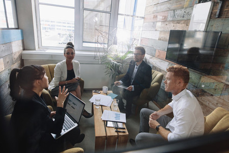 Young business colleagues meeting in modern office