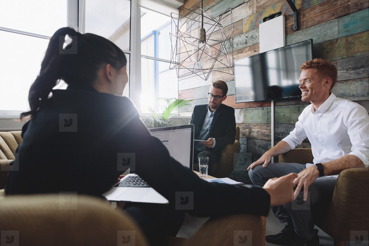 Business professionals in meeting room
