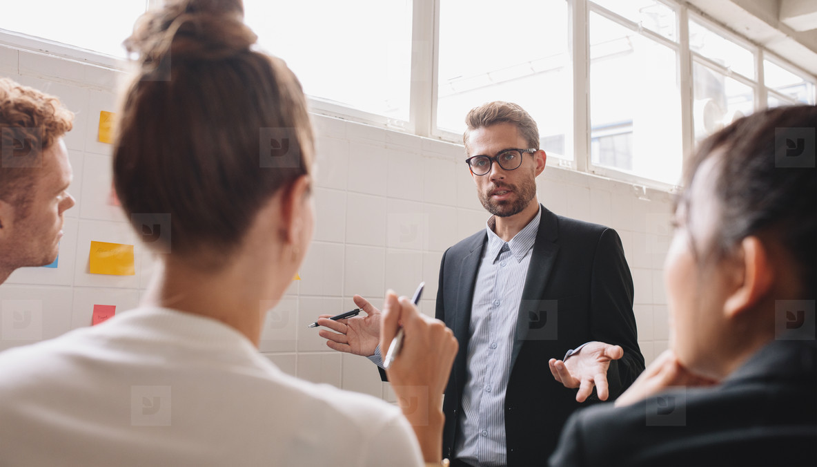 Businesspeople discussing in work in meeting room