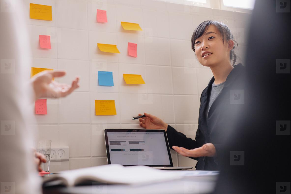 Female executive giving presentation