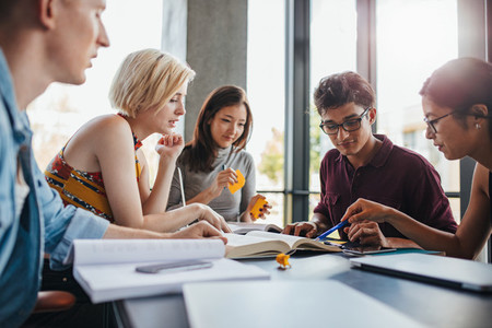 Diverse group of students studying at library