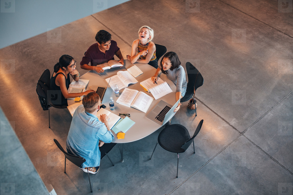 Group of students sitting together at table