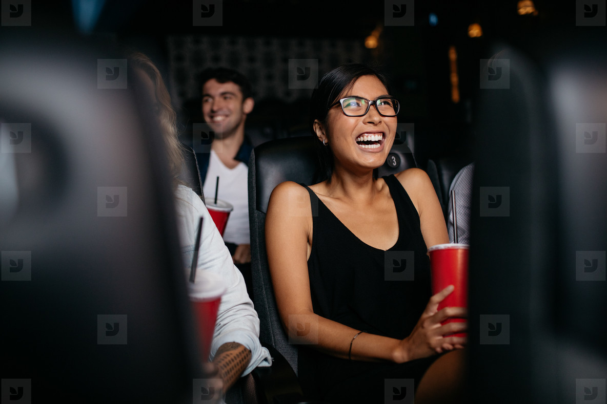 Woman watching movie in theater