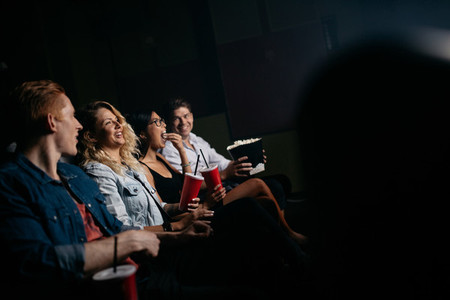 Young people watching movie in multiplex theater