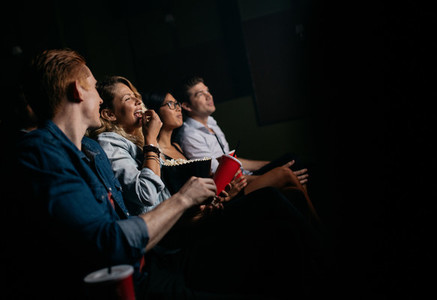 Group of people watching movie in cinema
