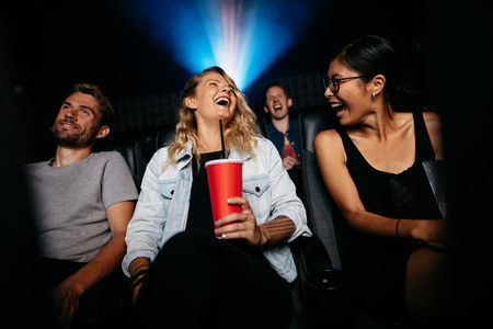 Group of people watching comedy movie in theater