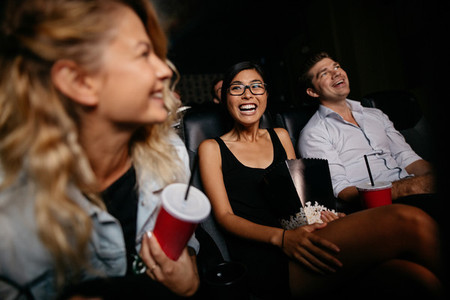 Young woman with friends watching