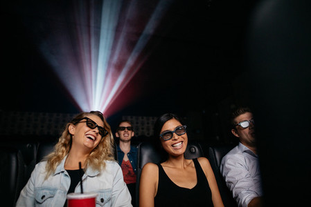 Young women watching 3d movie in cinema