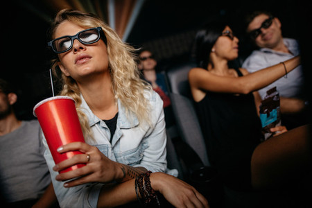 Woman watching 3d movie in theater