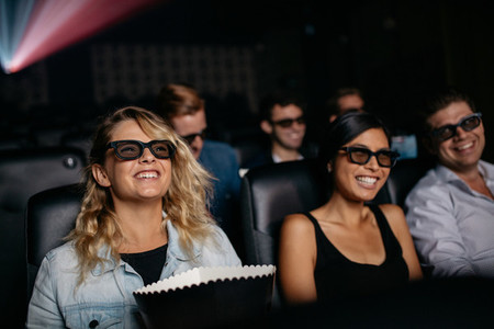 Group of friends watching 3d movie in cinema