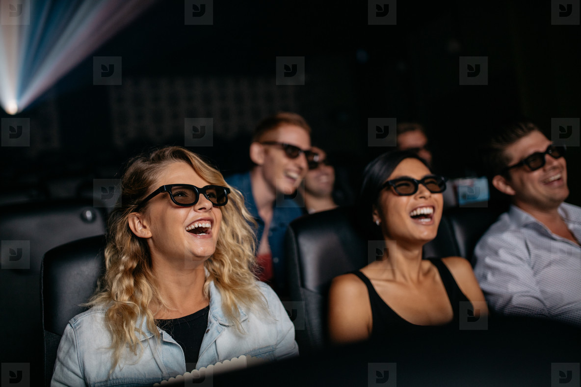 Friends watching 3d movie and laughing