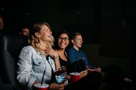 Group of young people watching movie