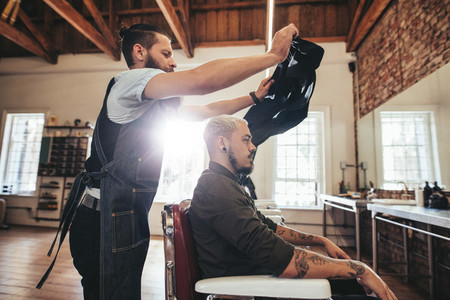 Hairstylist giving hair cute to customer