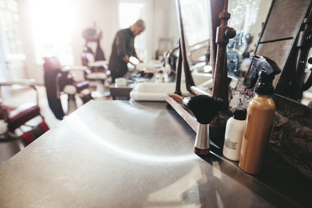 Hairdresser tools on counter at barber shop