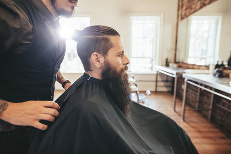 Man sitting at hair salon