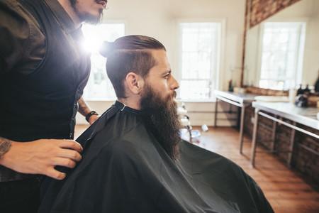 Man sitting at hair salon