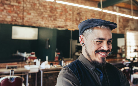 Successful male barber with cap
