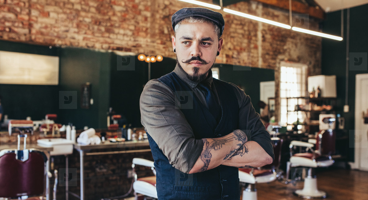 Male hairdresser standing in his shop