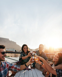 People celebrating with drinks at rooftop party