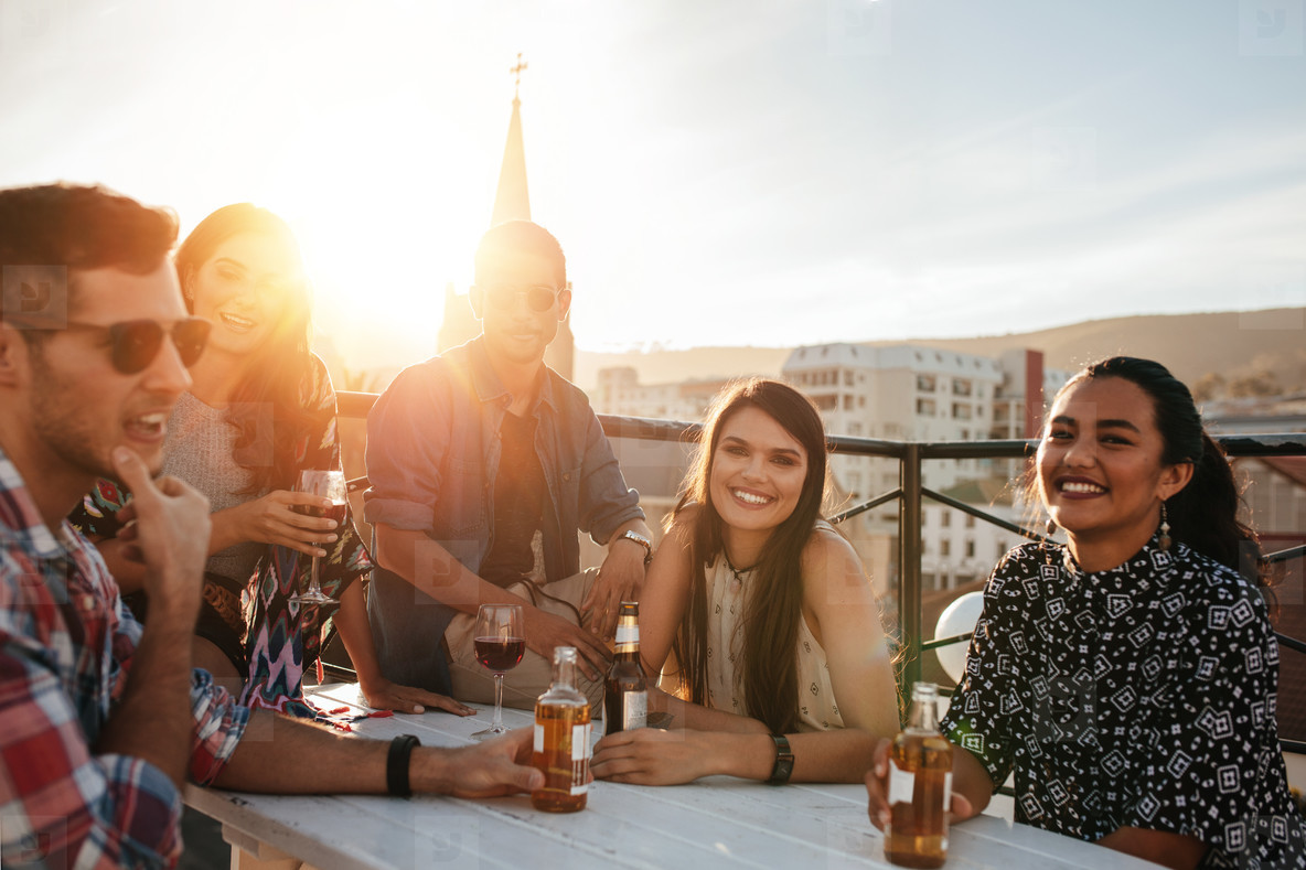 Group of happy young people having party