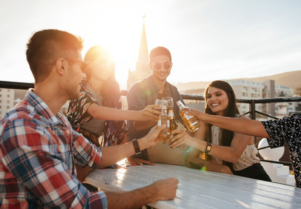 Group of friends enjoying party with drinks