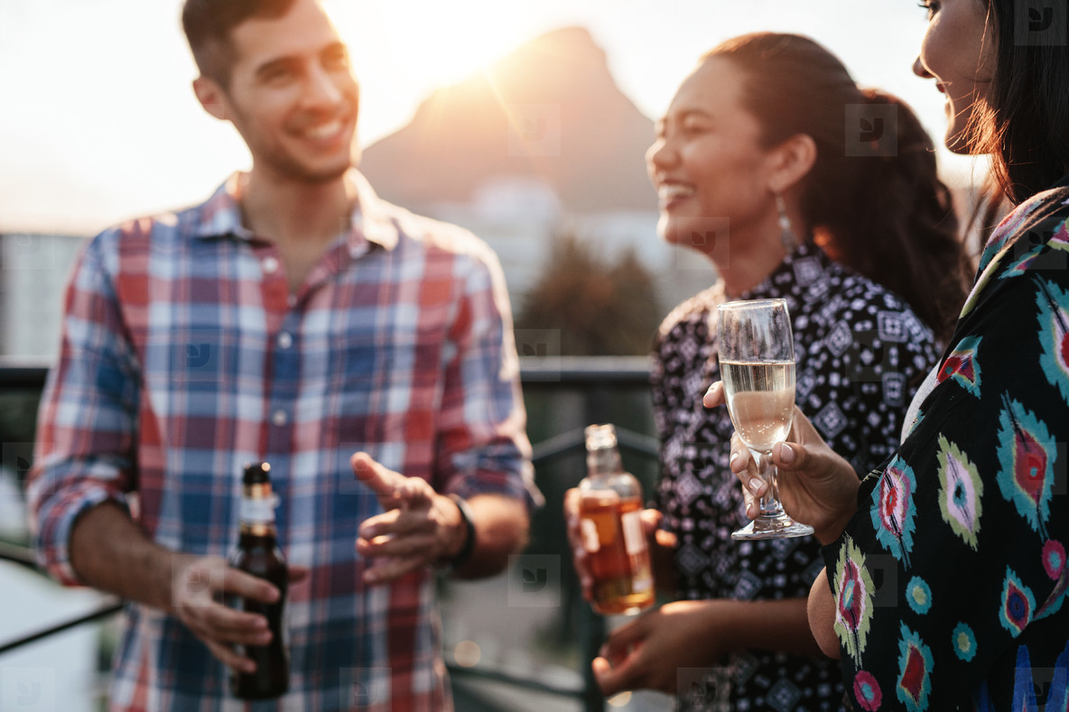Friends together on rooftop with drinks