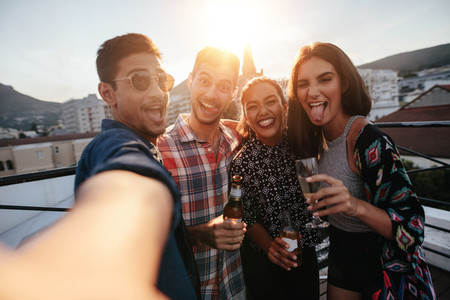 Group of people making a selfie at party