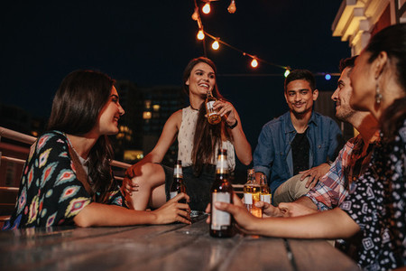 Friends enjoying party with drinks