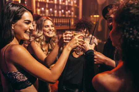 Young people with cocktails at nightclub