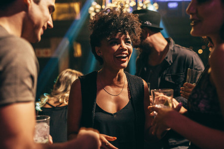 Woman enjoying at nightclub with friends