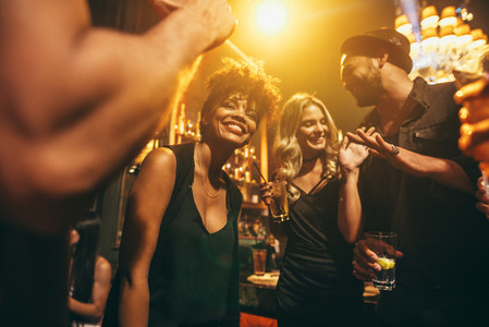 Happy young people having fun a nightclub