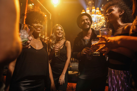 Group of young people having party at pub