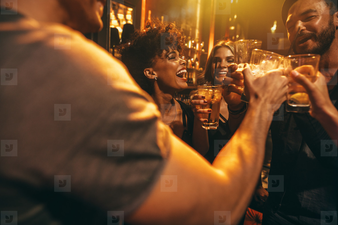 Young friends at nightclub having party