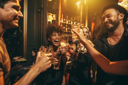 Young men and women enjoying a party