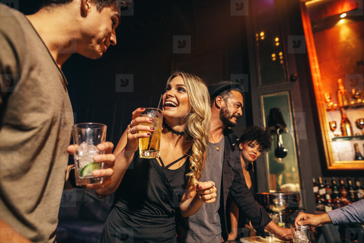 Group of people having fun at nightclub