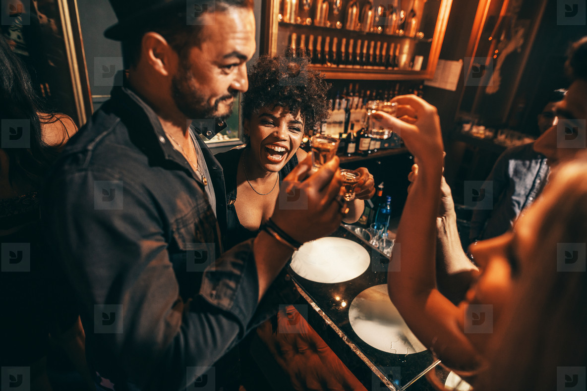 People having fun with drinks at nightclub
