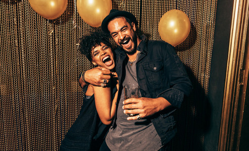 Happy young couple having fun at disco