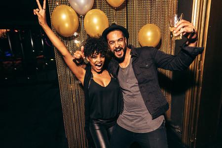 Couple having fun at disco party