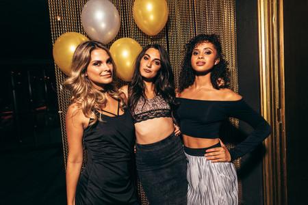 Stylish girls in the nightclub