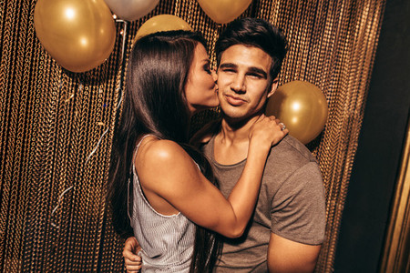 Loving young couple in the night club
