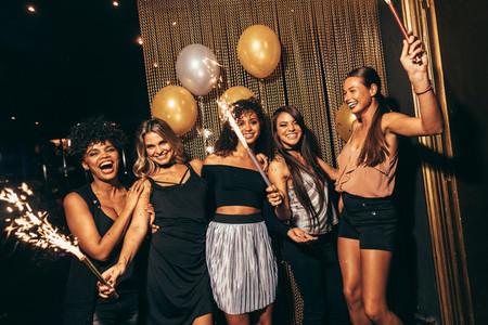 Stylish girls enjoying party at nightclub