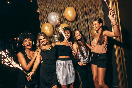 Stylish girls enjoying party at nightclub