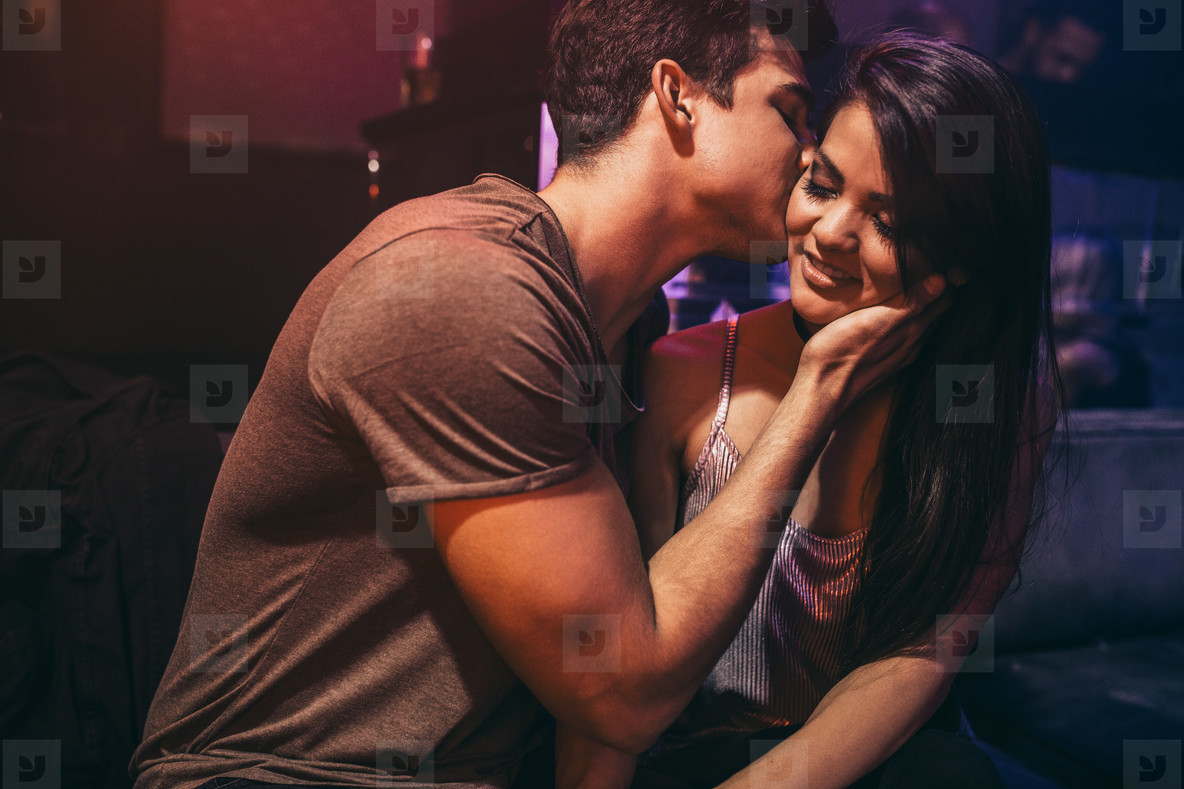 Young couple in love at lounge bar