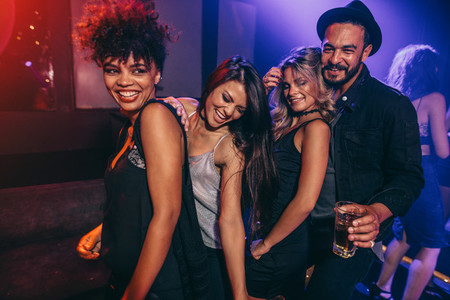 Group of friends dancing at disco club