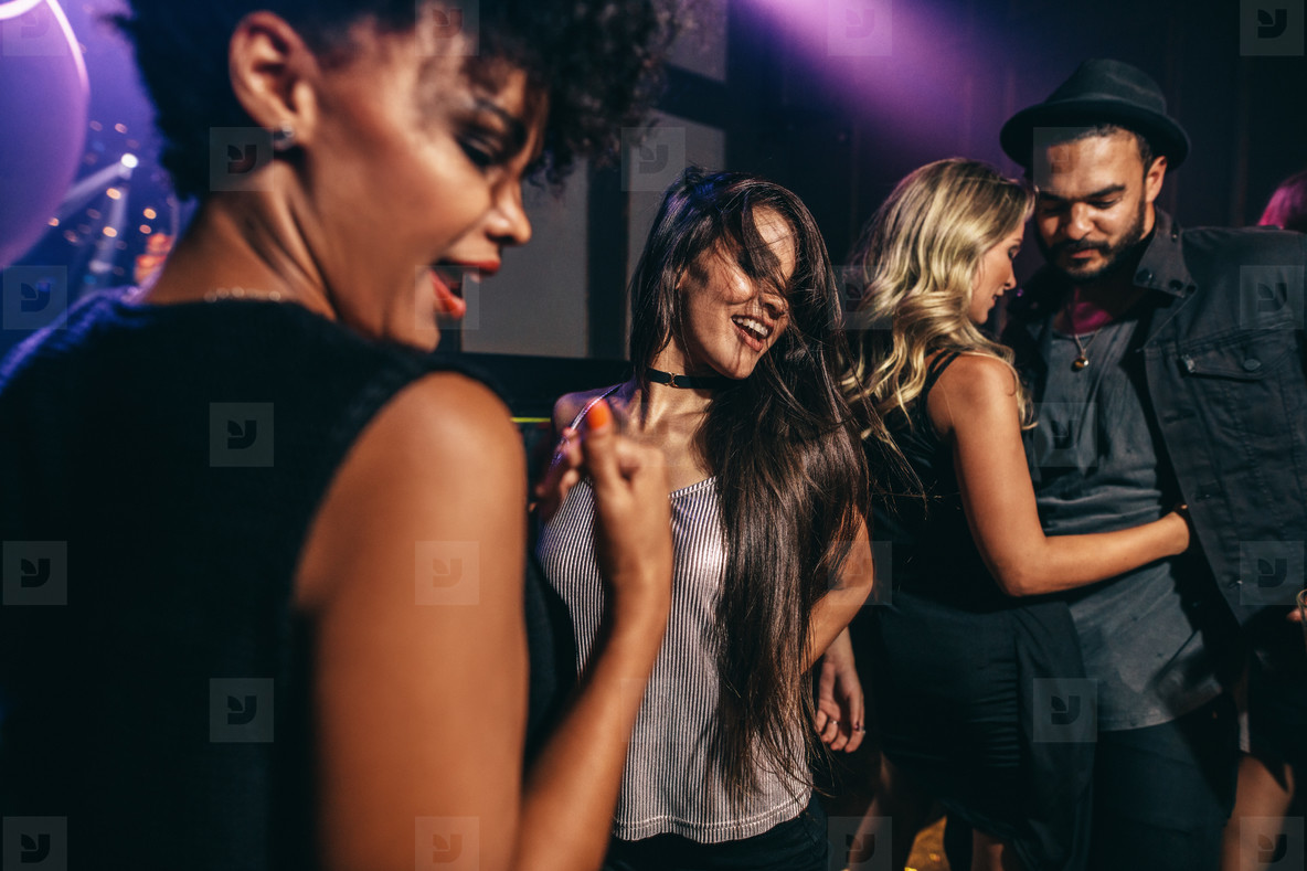 Friends having fun together at the nightclub